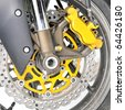 Closeup detail of a motorcycle's front wheel - stock photo