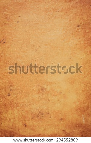Closeup detail of a ocher stone wall background. - stock photo