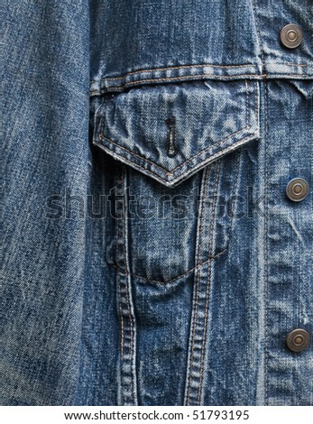 closeup detail of a vintage denim jacket - stock photo
