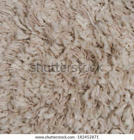 Closeup detail of beige carpet texture background. - stock photo