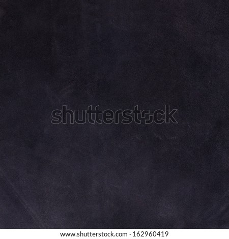 Closeup detail of blue suede texture background. - stock photo