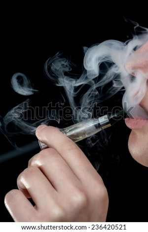 Closeup detail of Female with an Electronic Cigarette, Vertical shot - stock photo