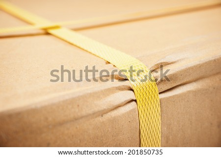 closeup detail of freight parcel with plastic strap - stock photo