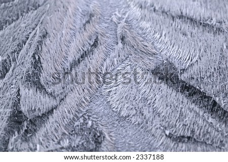 Closeup detail of frost on a car bonnet, with spectrum colours - stock photo