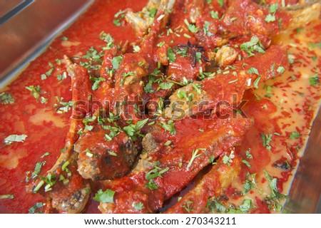 Closeup detail of gosht rogan josh meal on display at an indian restaurant buffet - stock photo