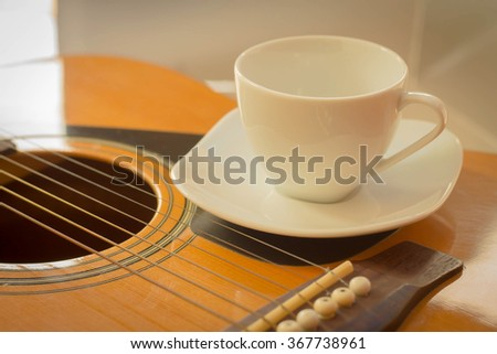 Closeup detail of guitar strings for playing music. - stock photo