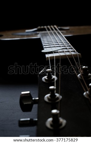 Closeup detail of guitar strings for playing music instrument talent strum strumming - stock photo