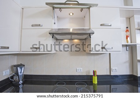 Closeup detail of kitchen area cooker top in luxury apartment show home - stock photo