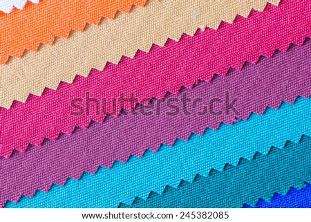 Closeup detail of multi color fabric texture samples. - stock photo