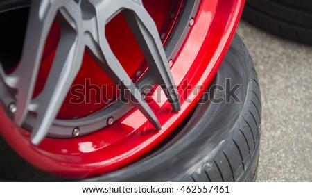 closeup detail of red aluminum car wheel