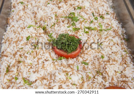 Closeup detail of rice with vermicelli dish on display at an oriental restaurant buffet - stock photo