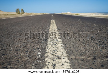 Closeup detail of view down a remote desert highway road