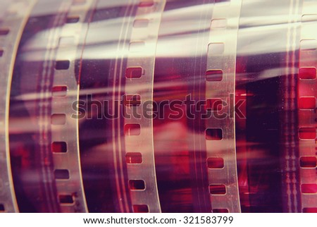 Closeup detail of vintage analog photography film strip background. - stock photo