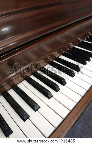 Closeup diagonal of a wooden upright piano - stock photo