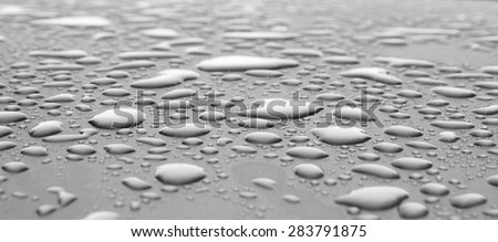 closeup drops of water on the car after rain - stock photo