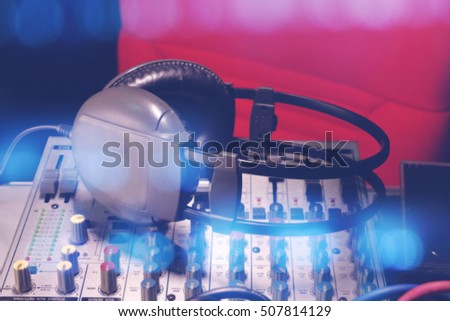 Closeup earphone on mixer background, soft focus