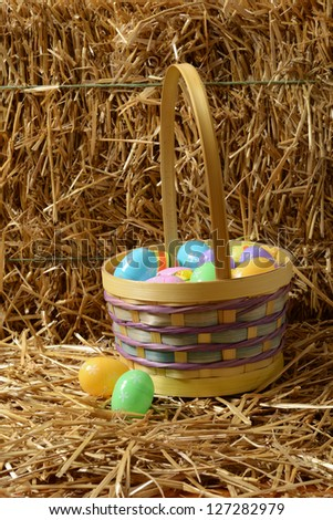 Closeup Easter eggs with basket and straw - stock photo