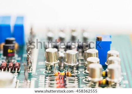 Closeup electronic hardware . Resistor and condensers assembly on the circuit board