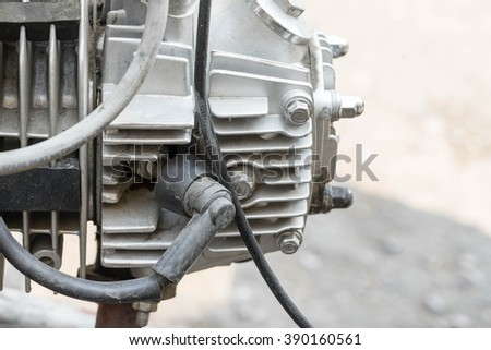 closeup engine of motorcycle on the road , point to motor - stock photo