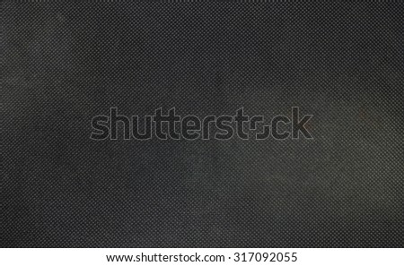 Closeup fabric at the black mouse pad background - stock photo