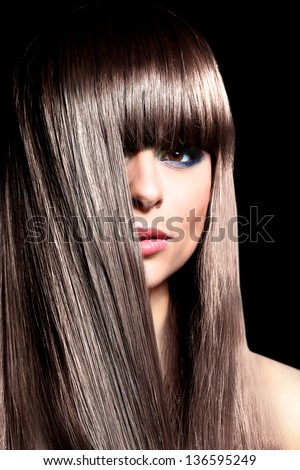 Closeup face of beautiful woman with long black curly hairs - stock photo
