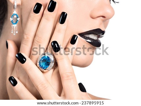 Closeup face of young beautiful woman with black manicure and fashion bright makeup. - stock photo
