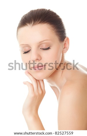 closeup face young woman with healthy clean skin and closed eyes isolated over white background - stock photo