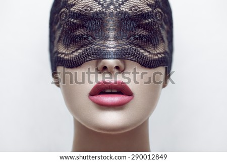 Closeup fashion beauty portrait of young beautiful girl in veil, with red lips. Professional makeup. - stock photo