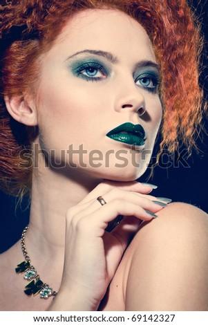 Closeup fashion portrait of a beautiful woman with creative makeup - stock photo