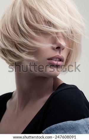 closeup fashion portrait of blonde beauty on white backround - stock photo