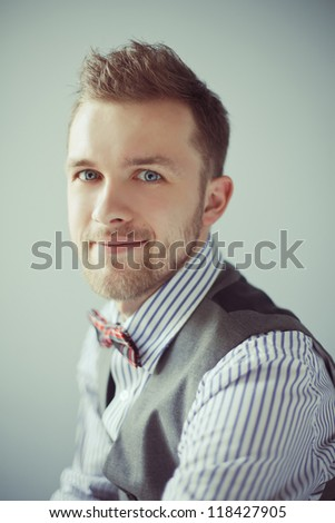 Closeup fashion portrait of young bearded model as business man - stock photo