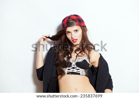 Closeup fashion studio portrait of hipster young woman