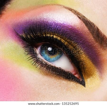Closeup female eye with beautiful fashion bright makeup - stock photo