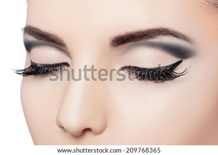 closeup female eyes with long eyelashes and black eyeliners - stock photo