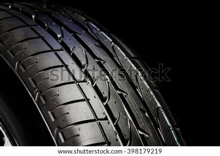 Closeup Fill light Tire dark background - stock photo