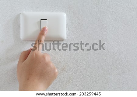 closeup finger press turn on/off electric-switch - stock photo