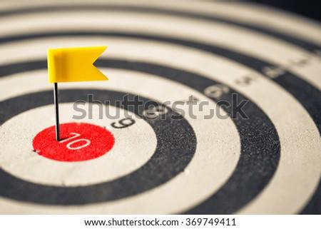 Closeup flag push pin in the center of dartboard - stock photo