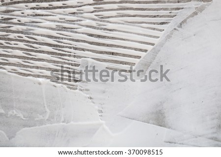 Closeup floor texture or abstract background. This texture of white adhesive latex on concrete floor created by worker's hand tool.  - stock photo