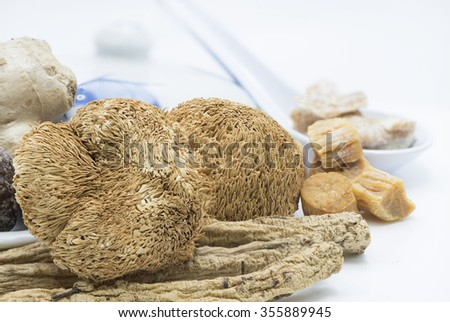 Closeup focus on dried hericium, an ingredient used in Chinese herbal soup for health benefit. The fleshy mushroom resemble a icicle-like spines, grow on dead or dying wood and tasted like lobster. - stock photo