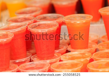Closeup food stall outdoor on street, cold fruit juice drink takeaway at London market - stock photo