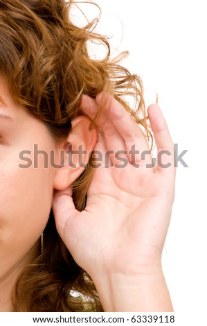 Closeup for female hand on ear. Listening. Vertical - stock photo