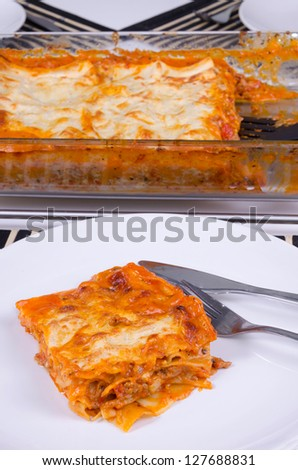 Closeup for portion of home made lasagna - stock photo