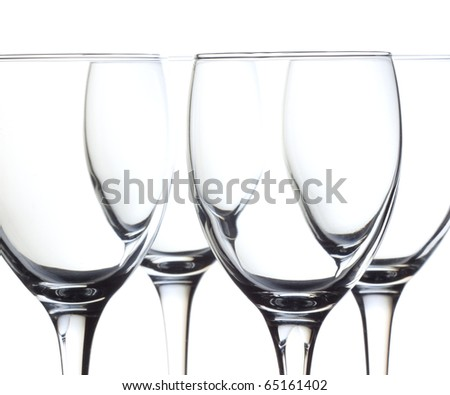 Closeup four empty wine glass on a white background - stock photo