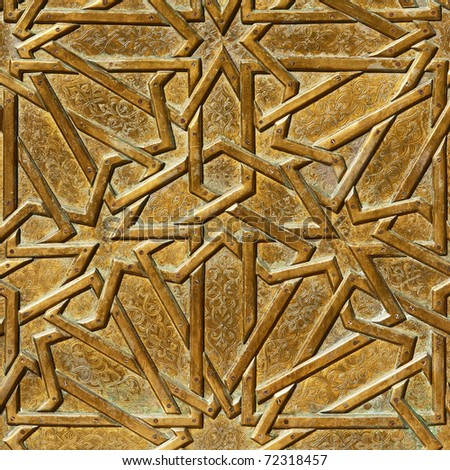 Closeup fragment of an old door, decorated by bronze geometrical ornament in retro east style.Useful for background. - stock photo