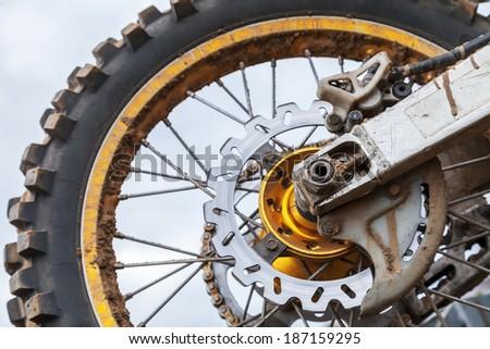 Closeup fragment of rear sport motocross bike wheel - stock photo