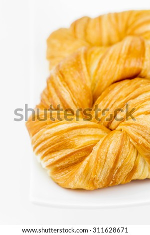 Closeup fresh and tasty croissant on white background