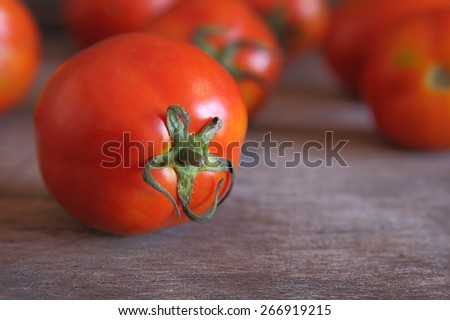 Closeup Fresh Red Tomato on Wooden Table. - stock photo