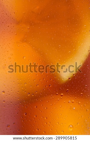 closeup from a cold cola glass with dew drops and ice cubes - stock photo