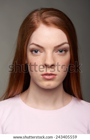 Closeup front view of red hair woman
