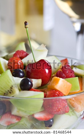Closeup fruit salad in a glass bowl, served on the table - stock photo